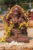 foto of ganesh  - View at the Ganesh statue with flowers  - JPG