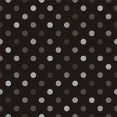 Seamless vector pattern with beige, brown and grey colorful polka dots on a black background