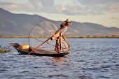 INLE LAKE, MYANMAR  DECEMBER 12, 2013: Fishermen at Inle Lake, Shan State, Myanmar Intha people poss