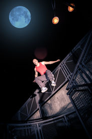 stock photo of parkour  - A young man at parkour training in the city