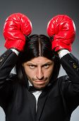 Man businessman with boxing gloves