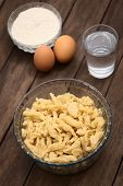 picture of glass noodles  - Glass bowl with homemade Hungarian Nokedli or Galuska a type of egg noddle made by cutting the soft dough on a wooden board into boiling water  - JPG