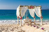 foto of wedding arch  - beach wedding set up - JPG