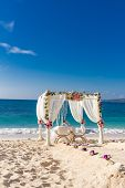 beach wedding set up, tropical outdoor wedding reception, beautiful cabana, wedding arch