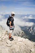 mountaineer on the summit of Jalovec peak in Julian alps - Slovenia