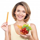 Beautiful young healthy woman with a plate of vegetables - isolated on white.