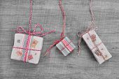 Presents For Christmas In Shabby Chic Or Style On A Wooden Background For A Coupon Or Greeting Card