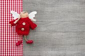 Red Checkered Guardian Or Christmas Angel In Country Style For A Greeting Card Or Gift Card
