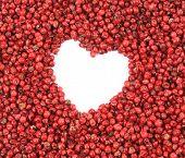 Red peppercorn in shape of heart.