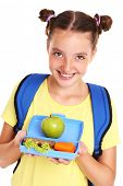 A picture of a schoolgirl eating healthy lunch over white background
