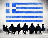 Silhouettes of Business People and a Flag of Greece