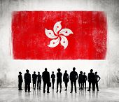 Silhouettes of Business People and a Flag of Hong Kong