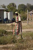 BOR, SOUTH SUDAN-DECEMBER 3 2010: Unidentified man walks through the village of Bor, South Sudan sho