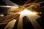Digitally generated Orange light wave over skyscrapers
