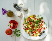 Summer organic kitchen preparing food with vegetable ingredients and creamy cheese