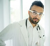 Portrait of attractive doctor on hospital office window