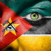 Mozambique Flag Painted On A Man's Face
