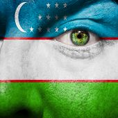 Uzbek Flag Painted On A Man's Face