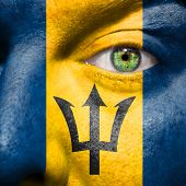 Barbadian Flag Painted On A A Man's Face