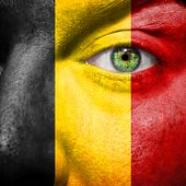 Belgian Flag Painted On A Man's Face