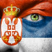 stock photo of serbia  - Flag painted on face with green eye to show Serbia support - JPG