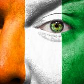 Flag Painted On Face With Green Eye To Show Cote D'ivoire Support