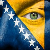 Flag Painted On Face With Green Eye To Show Bosnia Support