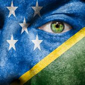 Flag Painted On Face With Green Eye To Show Solomon Islands Support