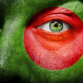 Flag Painted On Face With Green Eye To Show Bangladesh Support