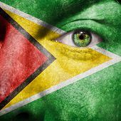 Flag Painted On Face With Green Eye To Show Guyana Support
