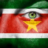 picture of suriname  - Flag painted on face with green eye to show Suriname support - JPG