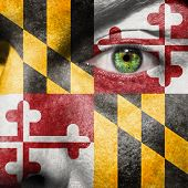 image of maryland  - Flag painted on face with green eye to show Maryland support - JPG