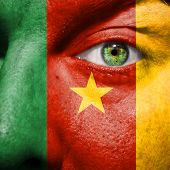 Cameroon Flag Painted On A Man's Face