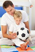 Blond Little Boy And His Father Playing With A Soccer Ball
