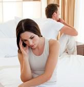 picture of bereavement  - Portrait of a sad couple having an argument in the bedroom - JPG