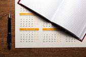 Wall Calendar With Pen And Diary Closeup