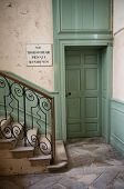 picture of bannister  - Entrance to private quarters in a historical house or castle that is open to the public with a staircase with ornate wrought iron railing - JPG