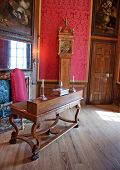 HAMPTON COURT, UK - AUGUST 03, 2014 - Working room with old desk and chair at Hampton Court Palace n
