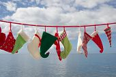 Seascape Of Hats And Socks Hanging - Blue Christmas Background With, Green, Red, White