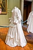 HAMPTON COURT, UK - AUGUST 03, 2014 - White baroque style female dress at Hampton Court Palace near London