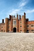 HAMPTON COURT, UK - AUGUST 3, 2014: Main Court at Hampton Court Palace. Hampton Court Palace is a royal palace in the London Borough of Richmond upon Thames, Greater London on August 03, 2014