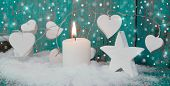 Christmas Candle In White With Turquoise Hearts, Wood And Snow For Decoration