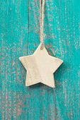 Hanging Wooden Star Decoration On Wooden Background For Christmas - Shabby Style