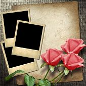 Photo On A Linen Background  With Red Roses
