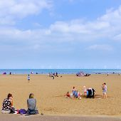 Families on Skegness beach, England