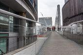 Tourists Walking A Causeway