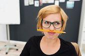 Macro Woman Putting Pencil Between Nose And Lip