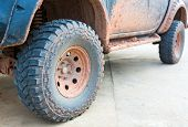 pic of four-wheel drive  - Muddy wheel - JPG