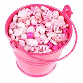 Beads for children in coloured metal bucket isolated on white