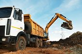 pic of dumper  - Heavy excavator loading dumper truck with sand in sandpit - JPG